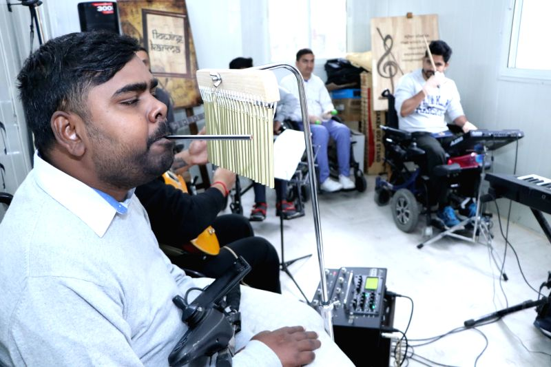 Chandigarh: Ajeya Raj, 28, playing chimes at Chandigarh Spinal Rehab, Sector 28 on Nov 21, 2019. (Photo: IANS)