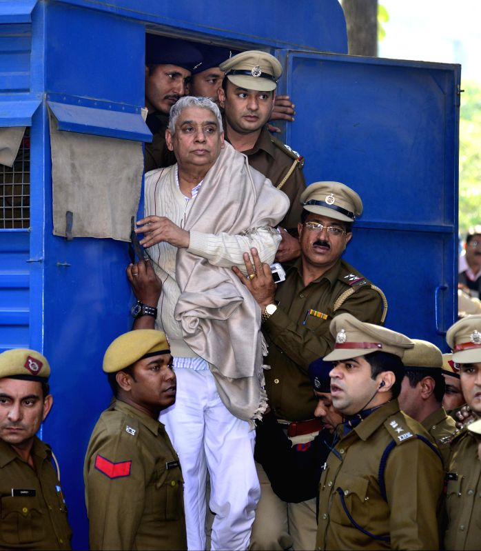 Controversial sect leader Rampal being produced to the Punjab and Haryana high court under heavy police protection in Chandigarh on Nov. 20, 2014.