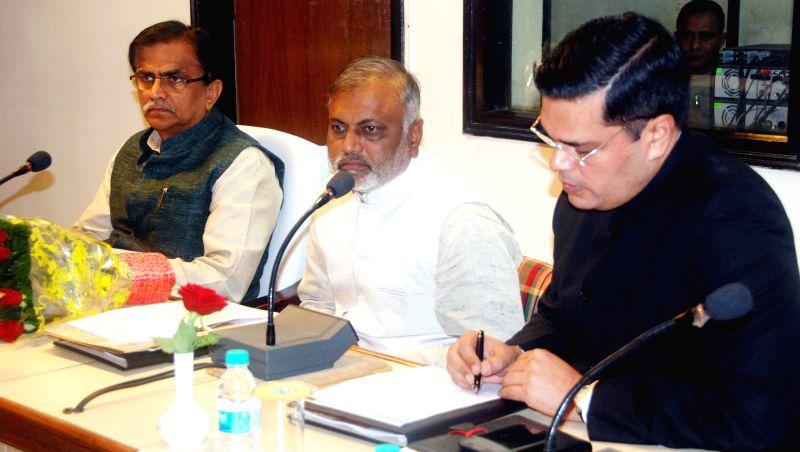 Haryana Agriculture Minister  O.P Dhankar and Haryana Minister Bikram Singh Yadav jointly preside over a meeting regarding Saansad Adarsh Gram Yojana (SAGY) in Chandigarh on Dec 11, 2014. - O. and Bikram Singh Yadav