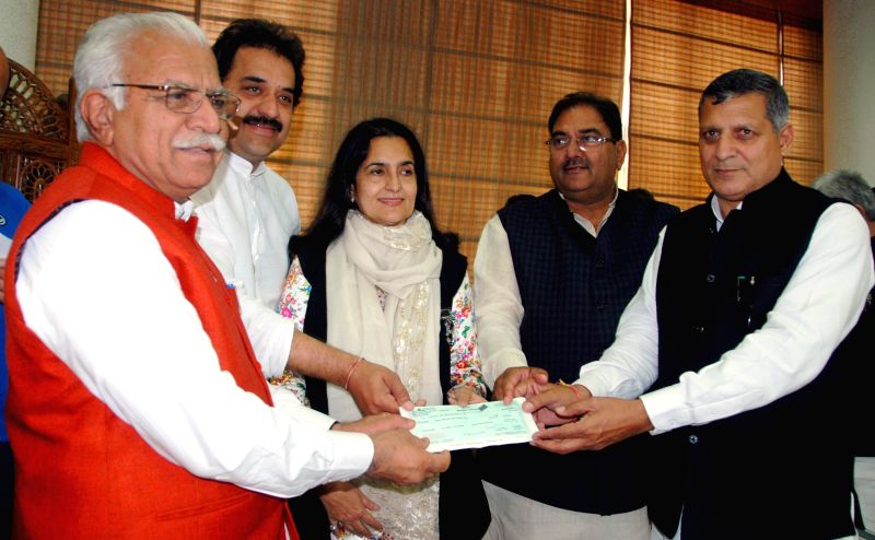 Haryana Assembly Speaker Kanwar Pal Gurjar presents a cheque of Rs 23 lakh 90 thousand to Chief Minister Manohar Lal Khattar on behalf of state legislators towards Chief Minister's ... - Kanwar Pal Gurjar and Manohar Lal Khattar