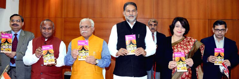 Haryana Chief Minister Manohar Lal Khattar, Haryana Tourism Minister Ram Bilas Sharma and others at the launch of 'Haryana Travel Guidebook' in Chandigarh, on Dec 12, 2014. - Manohar Lal Khattar and Bilas Sharma