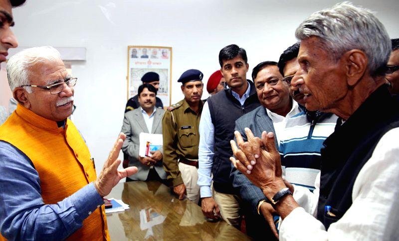 Haryana Chief Minister Manohar Lal Khattar listens to public grievances in Chandigarh, on Dec 12, 2014. - Manohar Lal Khattar