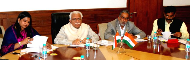 Haryana Chief Minister Manohar Lal Khattar during a meeting with Union Minister of State for Social Justice and Empowerment Krishan Pal Gurjar  in Chandigarh, on Feb 10, 2015. - Manohar Lal Khattar