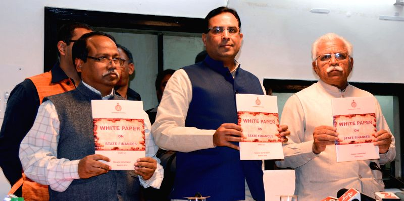 Haryana Chief Minister Manohar Lal Khattar and Haryana Finance Minister Captain Abhimanyu release `White Paper on State Finances` in Chandigarh on March 7, 2015. - Manohar Lal Khattar