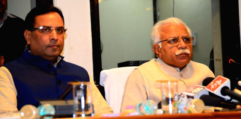 Haryana Chief Minister Manohar Lal Khattar and Haryana Finance Minister Captain Abhimanyu during a press conference in Chandigarh on March 7, 2015. - Manohar Lal Khattar