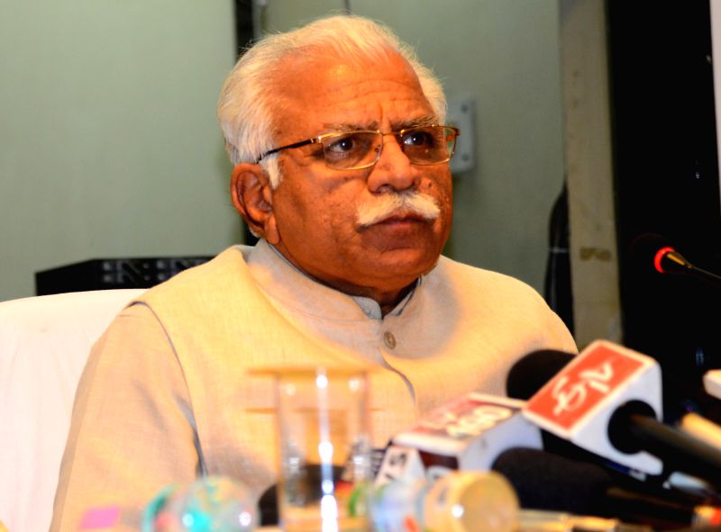 Haryana Chief Minister Manohar Lal Khattar addresses a press conference in Chandigarh on March 7, 2015. - Manohar Lal Khattar