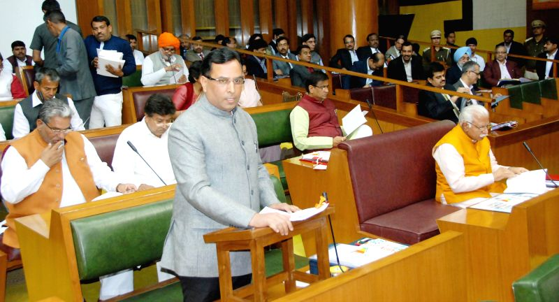 Haryana Finance Minister Capt Abhimanyu presents the state budget for 2015-16 in the state legislative assembly in Chandigarh, on March 17, 2015. - Capt Abhimanyu
