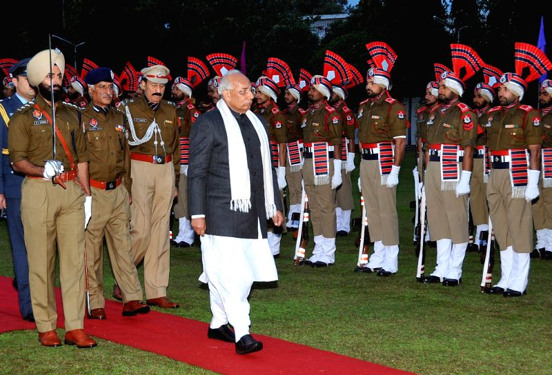 Haryana Governor Prof. Kaptan Singh Solanki, who assumed additional charge as the Governor of Punjab inspects guard of honour at Punjab Raj Bhawan in Chandigarh, on Jan 22, 2015. - Kaptan Singh Solanki