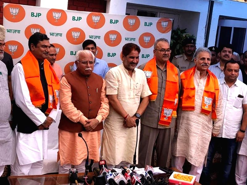 Chandigarh: Indian National Lok Dal's (INLD) Nuh legislator Zakir Hussain and Julana's Parminder Singh Dhull join the BJP in the presence of Haryana Chief Minister Manohar Lal Khattar and state party chief Subhash Barala, in Chandigarh on June 25, 20