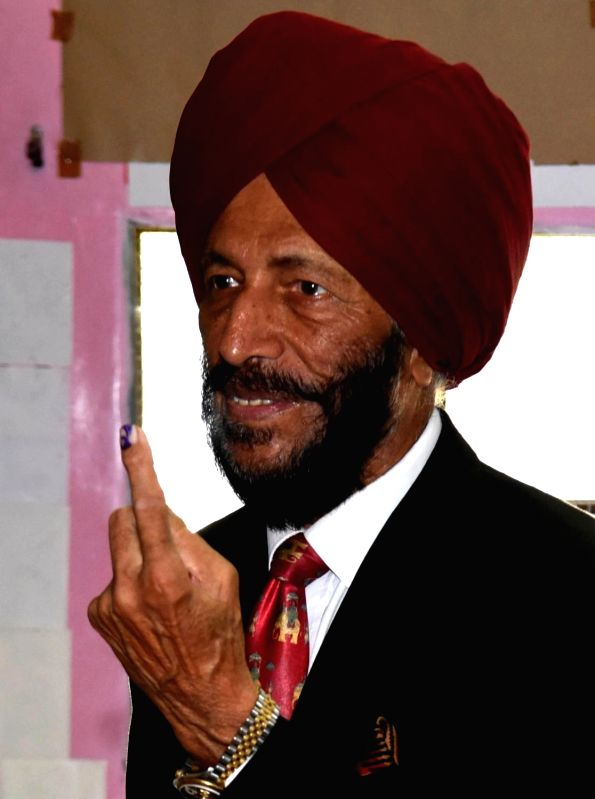 Chandigarh: Legendary sprinter Milkha Singh, shows his forefinger marked with indelible ink after casting vote during the last phase of 2019 Lok Sabha polls, in Punjab's Chandigarh, on May 19, 2019. (Photo: IANS)