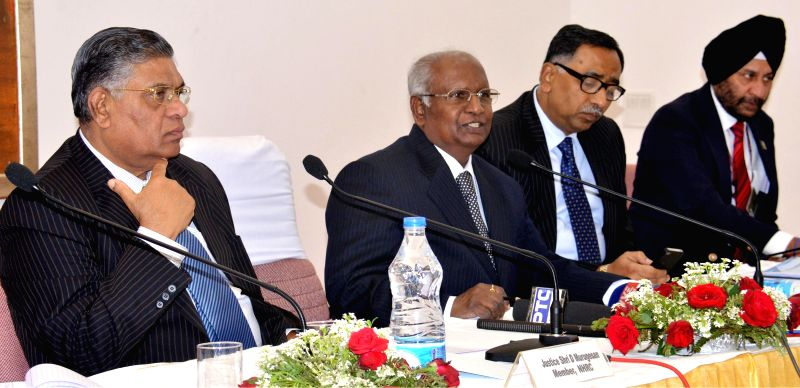 National Human Rights Commission chairperson Justice K.G. Balakrishnan addresses press in Chandigarh on Nov 28, 2014. Also seen NHRC members Justice D. Murugesen and S.C. Sinha. - C. Sinha