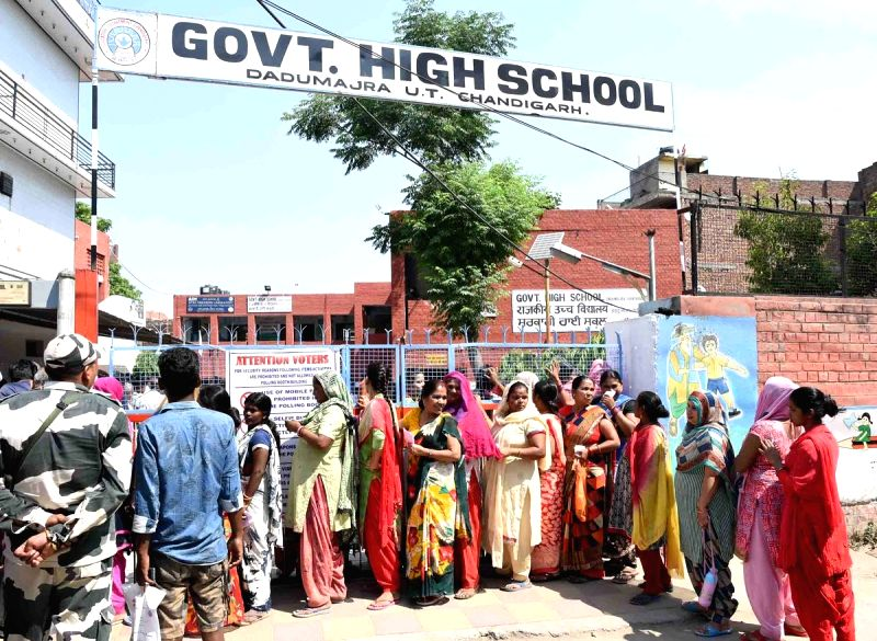 Chandigarh: People stand in queue to cast vote during the last phase of 2019 Lok Sabha polls, at Daddu Majra, in Chandigarh, on May 19, 2019. (Photo: IANS/PIB)