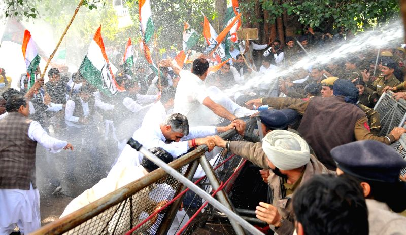 Police charge water cannons on Congressmen marching towards Haryana Assembly in Chandigarh, on March 9, 2015.