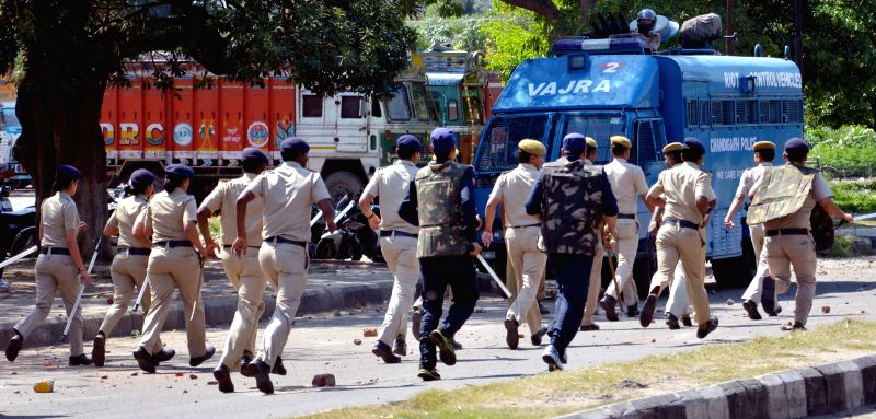 Police lathi charge to disperse violent protesters after a three-year-old girl was found raped and murdered in Chandigarh on April 11, 2015.