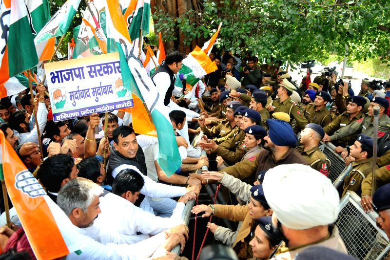 Policemen try to stop Congressmen marching towards Haryana Assembly in Chandigarh, on March 9, 2015.