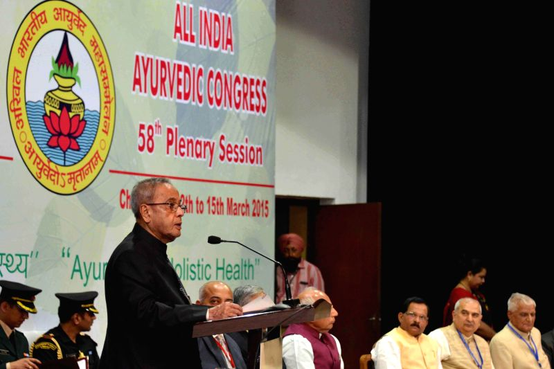 President Pranab Mukherjee addresses at the inauguration of the 58th Plenary Session of All India Ayurvedic Congress, at Chandigarh, in Punjab on March 14, 2015. Also seen The Minister of ...