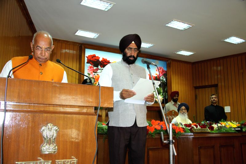 Punjab and Haryana governor Kaptan Singh Solanki administers oath to the office to Nidharak Singh Brar as the State Information Commissioner, Punjab at Punjab Raj Bhawan in Chandigarh on ... - Kaptan Singh Solanki