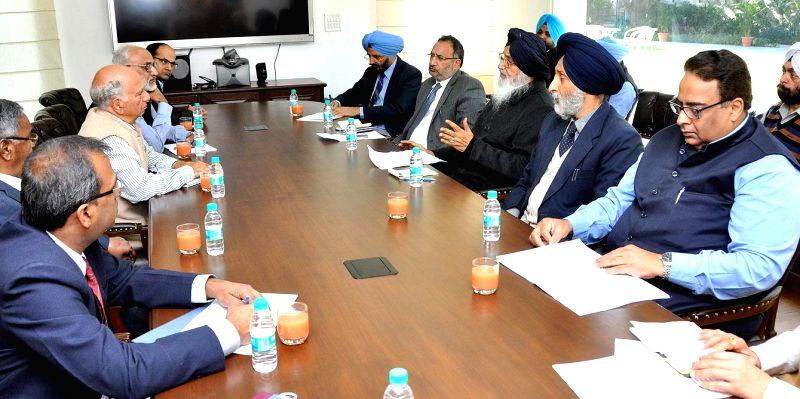 Punjab Chief Minister Parkash Singh Badal during a meeting with FCI chairman Shanta Kumar in Chandigarh, on Nov 28, 2014. - Parkash Singh Badal and Shanta Kumar