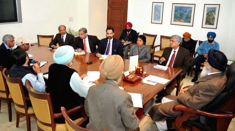 Punjab Chief Minister Parkash Singh Badal during a meeting with a team of experts led by the Director of Tata Memorial Center Dr. R A Badwe in Chandigarh on Dec 15, 2014. - Parkash Singh Badal