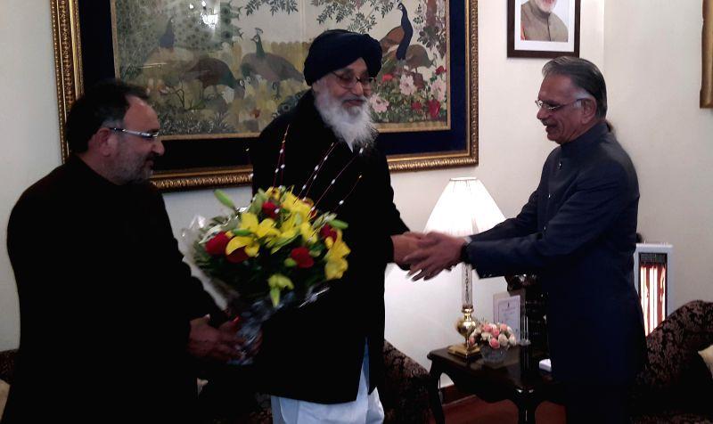 Punjab Chief Minister Parkash Singh Badal calls on Punjab Governor Shivraj V. Patil in Chandigarh on Jan. 5, 2015. - Parkash Singh Badal and Shivraj V. Patil