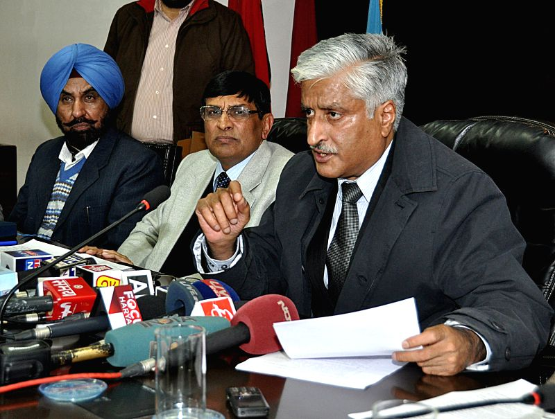 Punjab DGP Sumedh Singh Saini addresses during a press conference in Chandigarh on Jan. 7, 2014. - Sumedh Singh Saini