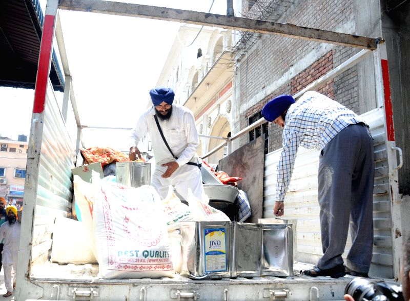 Shiromani Gurdwara Parbandhak Committee (SGPC) members load relief materials departing for earthquake hit Nepal from Chandigarh on April 28, 2015.