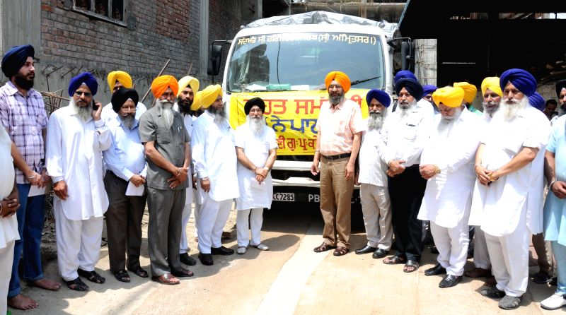 Shiromani Gurdwara Parbandhak Committee (SGPC) members flags-off a relief material departing for earthquake hit Nepal from Chandigarh on April 28, 2015.