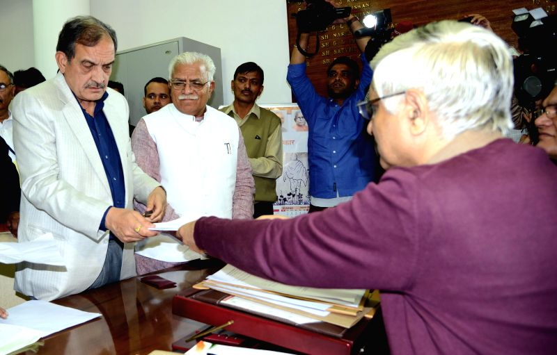 Chandigarh : The Union Minister for Rural Development, Panchayati Raj, Drinking Water and Birender Singh files his nomination papers for Rajya Sabha elections from Haryana in Chandigarh on Nov 25, ... - Manohar Lal Khattar