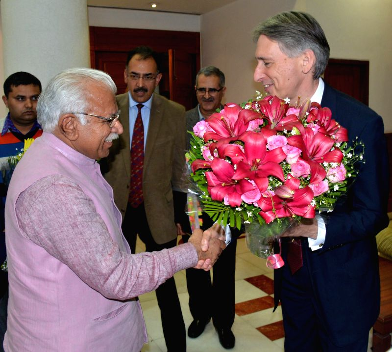 United Kingdom Secretary of State for Foreign and Commonwealth Affairs Philip Hammond calls on Haryana Chief Minister Manohar Lal Khattar in Chandigarh on March 11, 2015. - Manohar Lal Khattar