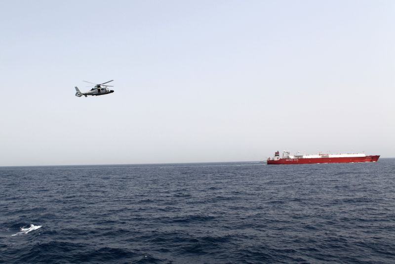 A helicopter of a convoy fleet of Chinese Navy is seen during an escort mission in the Gulf of Aden, Aug. 19, 2014. The 17th and the 18th Chinese Navy ...
