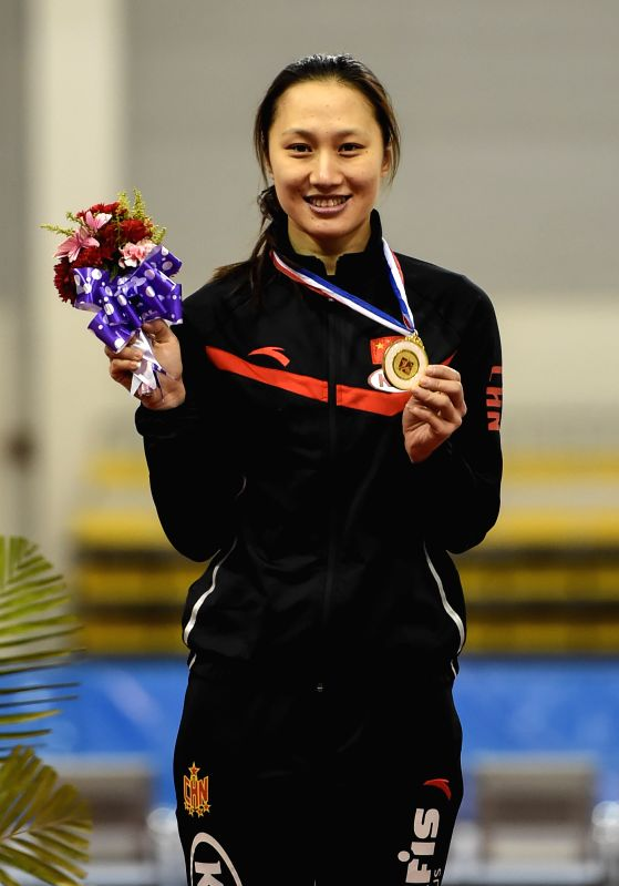 China's Zhang Hong poses during the awarding ceremony of the women's 500m event at the Asian Single Distances Speed Skating Competition in Changchun, capital of ..