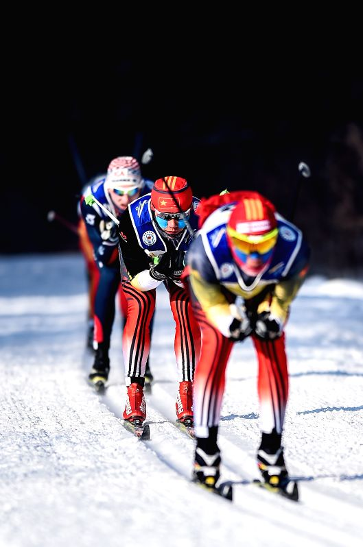 Athletes compete during the 50km classic in FIS cross-country skiing race in Changchun, capital of northeast China's Jilin Province, Jan. 2, 2015. (Xinhua/Wang ...