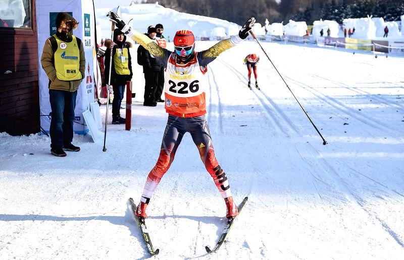 China's Li Hongxue celebrates after finishing the women's 50km classic in FIS cross-country skiing race in Changchun, capital of northeast China's Jilin Province, .