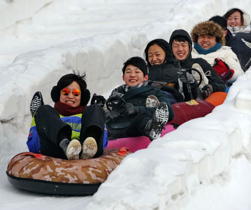 Visitors have fun at a ski resort in Changchun, capital of northeast China's Jilin Province, Jan. 20, 2015. Many visitors and citizens went to ski resorts or hot .