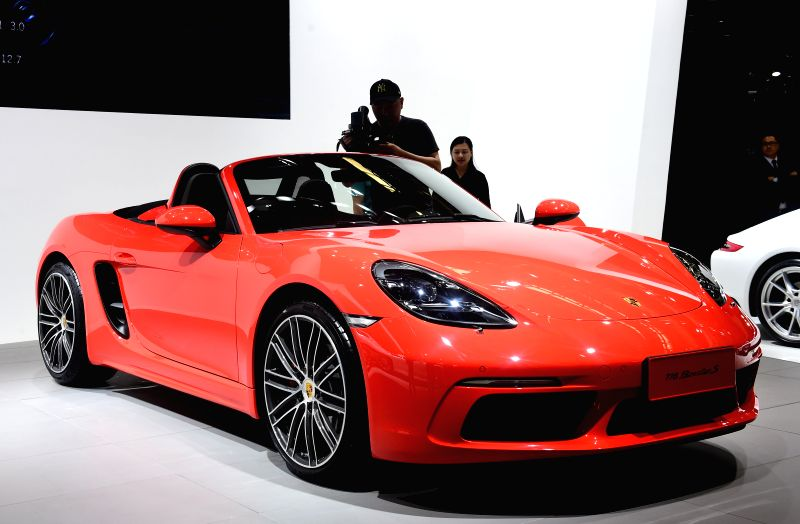 CHANGCHUN, July 15, 2016 - A videographer records a Porsche car at the 13th China Changchun International Automobile Expo held in Changchun, northeast China's Jilin Province, July 15, 2016. More than ...