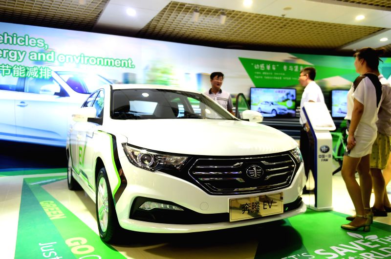 CHANGCHUN, July 15, 2016 - Visitors watch a Besturn hybrid car at the 13th China Changchun International Automobile Expo held in Changchun, northeast China's Jilin Province, July 15, 2016. More than ...