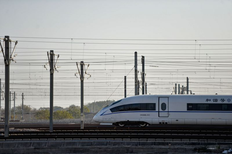A bullet train leaves the Changsha South Railway Station, a stop of the Shanghai-Kunming high-speed railway, in Changsha, capital of central China's Hunan Province, Dec. 16, 2014. The ...