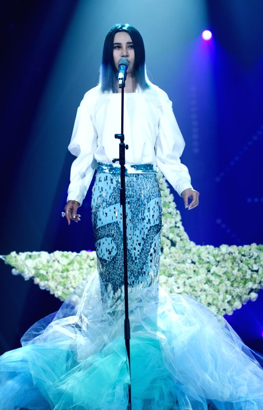 """Singer Shang Wenjie performs in the biennial concert of """"I'm a singer"""", a reality music show for professional singers, in Changsha, capital of central .."""