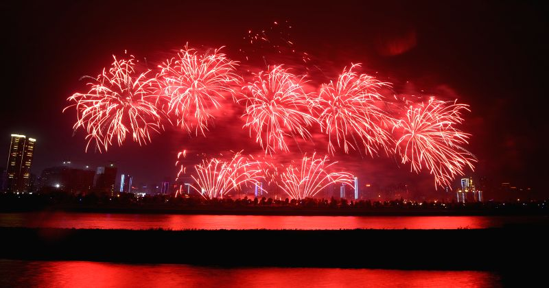 Fireworks are seen over the Xiangjiang River in Changsha, capital of central China's Hunan Province, May 3, 2014. Fireworks are exploded in Changsha on Saturdays ...