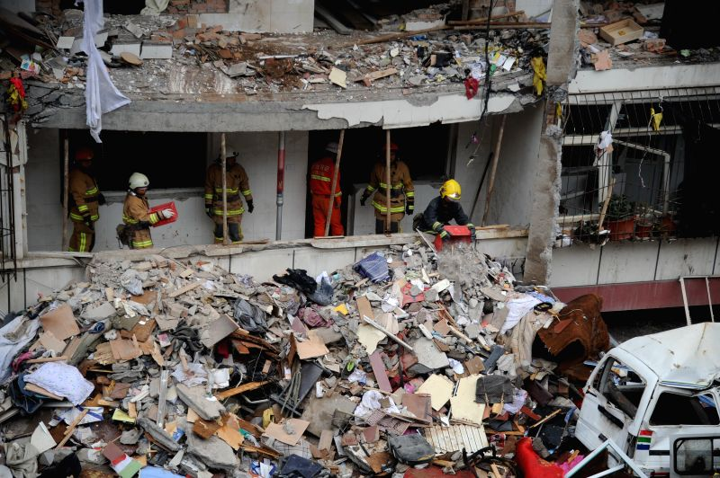 Rescuers work at the site of an explosion in Changzhi, north China's Shanxi Province, Aug. 17, 2014. Seven people died and four were injured after an explosion at .