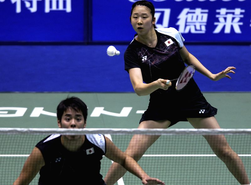 CHANGZHOU, April 19, 2017 - Kohei Gondo and Wakana Nagahara(R) of Japan return the shuttlecock during the mixed doubles' first round match against China's Zhang Nan and Li Yinhui at China Masters ...