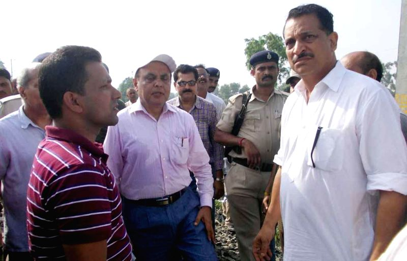 Chapra MP Rajiv Pratap Rudy at the site of where nine out of twelve bogies of Delhi-Dibrugarh Rajdhani Express were derailed near Golden Ganj railway station in Bihar's Saran district on June 25, ...