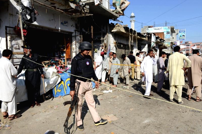 Pakistani policemen stand guard at the site of a blast in northwest Pakistan's Charsadda, on April 22, 2014. At least four people were killed and 33 others ...