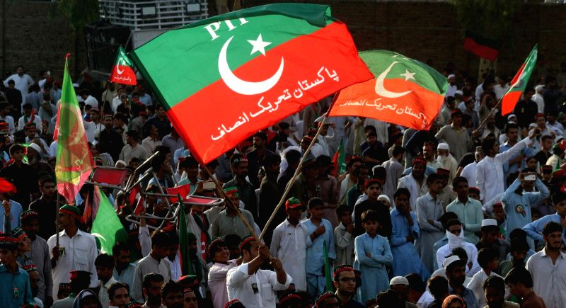CHARSADDA (PAKISTAN), July 5, 2018 Supporters of Imran Khan, head of the Pakistan Tehreek-i-Insaf (PTI), attend an election campaign rally in Charsadda district of Khyber Pakhtunkhwa ... - Imran Khan