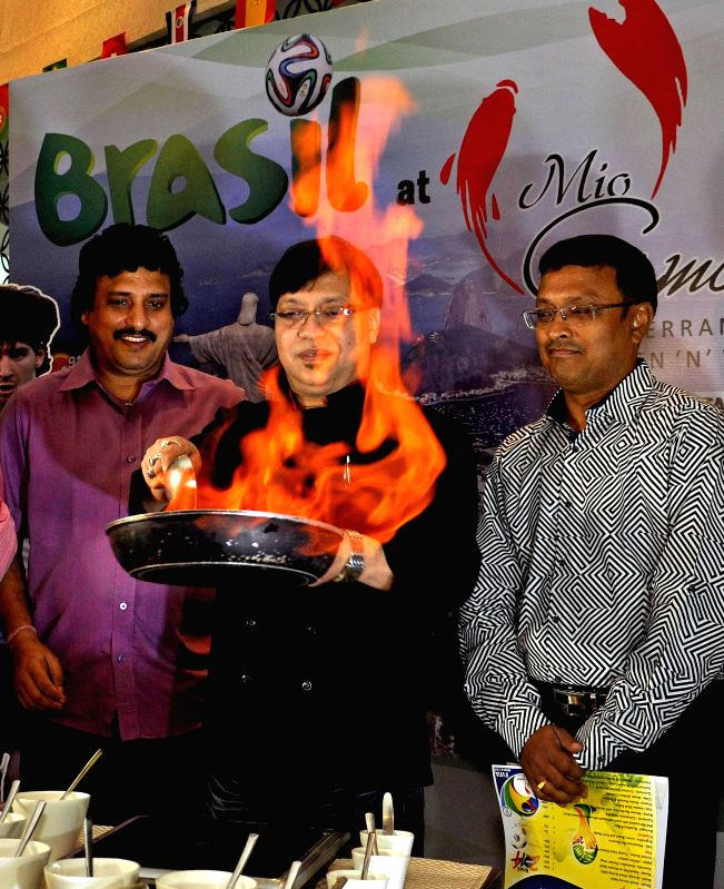 Chef Pradip Rozario with special dishes named after all 32 nations which qualified for the FIFA World Cup 2014 during World Cup football food festival in Kolkata on June 17, 2014.