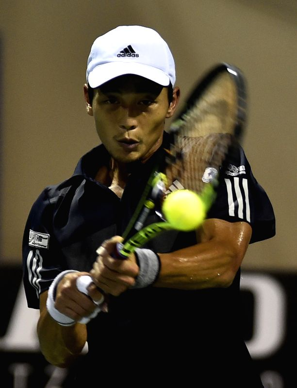 Taiwanese tennis player Lu Yen-hsun in action against India's Somdev Devvarman during the first round match of ATP Chennai Open 2015 in Chennai on Jan 6, 2015.