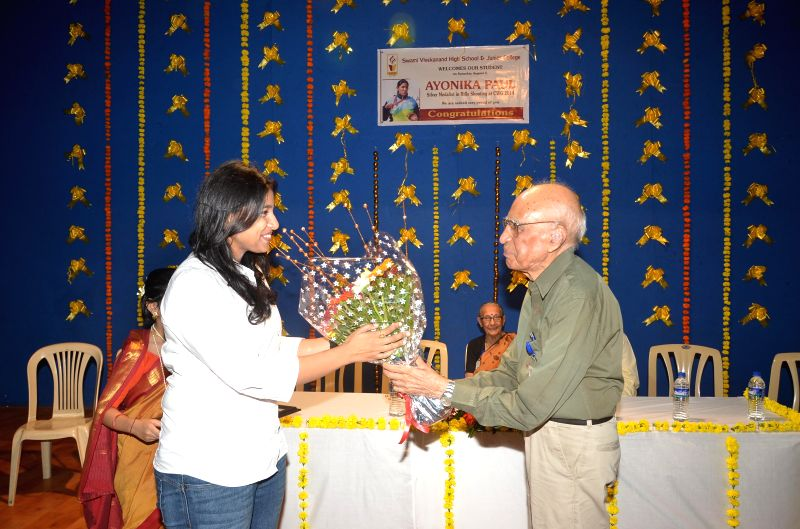 Chembur girl Ayonika Paul, who won the Glasgow CWG Silver Medal, visited her alma mater Vivekanand High School where she was honoured by school president Ram Keswani in Mumbai on August 2, 2014.