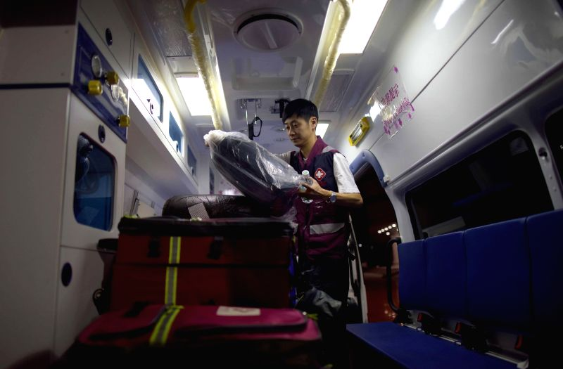 A member of a medical team loads medical supplies in Chengdu, southwest China's Sichuan Province, April 26, 2015. A team made of 58 medical staff departed from ...
