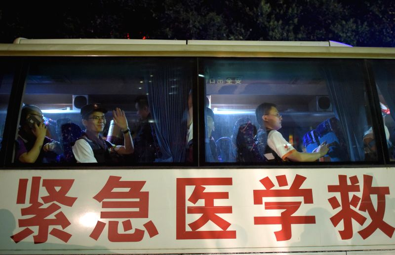 Members of a medical team wave on their departure from Chengdu, southwest China's Sichuan Province, April 26, 2015. A team made of 58 medical staff departed from ...