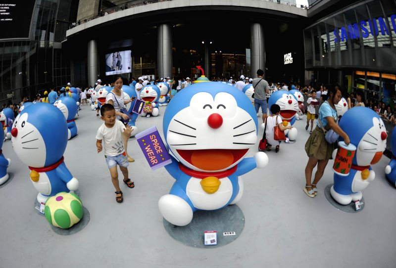 Citizens visit a Doraemon exhibition in Chengdu, capital of southwest China's Sichuan Province, Aug. 16, 2014. The exhibition kicked off here on Saturday. A hundred